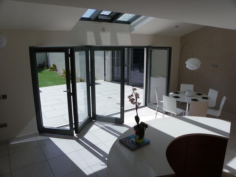 Folding sliding door gallery uniwin windows doors for Retractable sliding doors