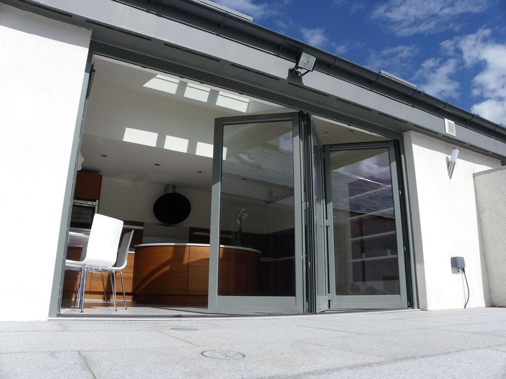 Folding sliding doors uniwin windows doors for Folding sliding doors